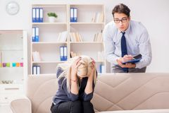The young woman visiting psychiatrist man doctor for consultation. Young women visiting psychiatrist men doctor for consultation Royalty Free Stock Image