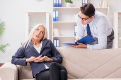 The young woman visiting psychiatrist man doctor for consultation. Young women visiting psychiatrist men doctor for consultation Stock Images