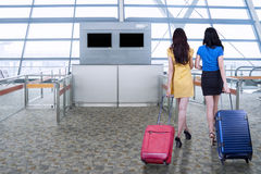 Young women walk in airport Royalty Free Stock Image