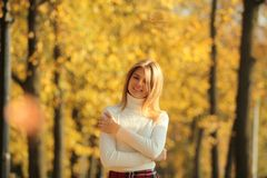 Young women walking autumn park fanny sunny day. Women walking autumn park fanny sunny day royalty free stock images