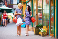 Young women walking the city stores, shopping Royalty Free Stock Photo