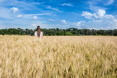 Young women walking through a Golden weed  field. Argentina countryside. Royalty Free Stock Photography