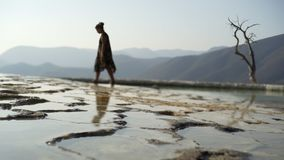 Mexico Hierve el Agua;. Young women walking on mineral cascade in mountain, Mexico Hierve el Agua stock video