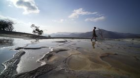 Mexico Hierve el Agua;. Young women walking on nature mineral cascade,wide angle shot, Mexico Hierve el Agua stock video footage