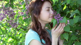 Young women walking outside in a park lilac tree.  stock footage
