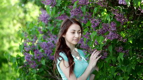 Young women walking outside in a park lilac tree stock footage