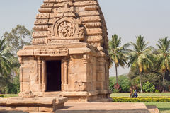 Young women walking past ancient Hindu temple Stock Photos