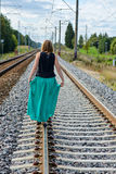 Young women walking on the rail track Royalty Free Stock Photo