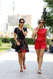 Young women walking in the summer city Royalty Free Stock Photos