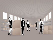 Young women in warehouse Royalty Free Stock Image