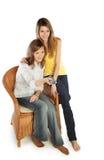 Young women watch TV stock photos