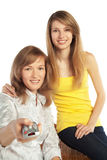 Young women watch TV Royalty Free Stock Photos