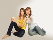 Young women watch TV Stock Images