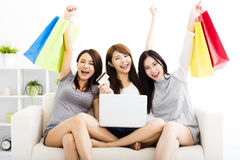 Young women watching laptop with on line shopping. Three young women watching laptop with on line shopping concept Stock Photos