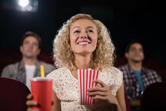 Woman watching movie in theatre royalty free stock photography