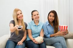 Young Women Watching Television Stock Images