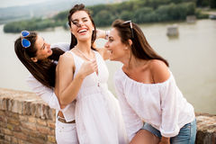 Young women on the waterfront Stock Photography