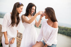 Young women on the waterfront Royalty Free Stock Photos