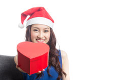 Young women wearing Christmas hats Stock Images