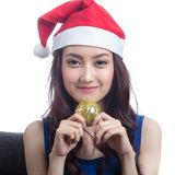 Young women wearing Christmas hats Stock Photos