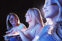 Young Women Wearing 3D Glasses In Theatre Stock Image
