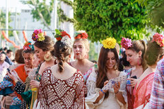 Young women wearing traditional flamenco dress at the April Fair Seville Stock Photography