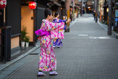 Young women wearing traditional japanese kimono walk on the street of Gion Royalty Free Stock Images