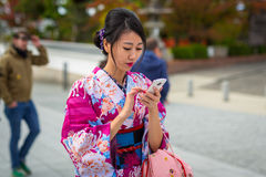 Young women wearing traditional japanese kimonos Stock Image