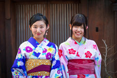 Young women wearing traditional japanese kimonos Royalty Free Stock Photos