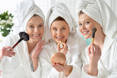 Young women wearing a white bathrobes Royalty Free Stock Images