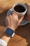 Young women wears smart watch at coffee shop Stock Photos