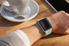 Young women wears smart watch at coffee shop Stock Images