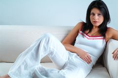 Women on white  couch Stock Photos