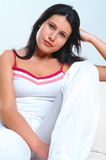 Women on white  couch. Young Women on white  couch Royalty Free Stock Image