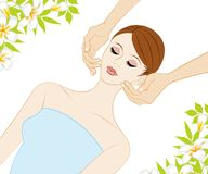 Young Women who receive face massage Stock Photography