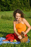 Young Women will get from basket fruits in garden Royalty Free Stock Photos