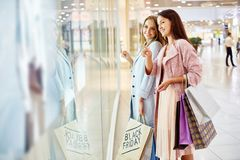 Young Women Window Shopping in Mall royalty free stock image