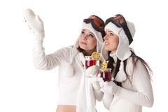 Young women in winter clothes drink mulled wine. Royalty Free Stock Photo