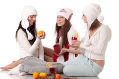 Young  women in winter clothes with mulled wine. Royalty Free Stock Photos