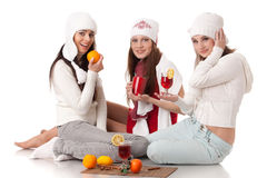 Young  women in winter clothes with mulled wine. Stock Photography