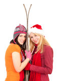 Young women in winter hats holding old wooden skis Royalty Free Stock Photos