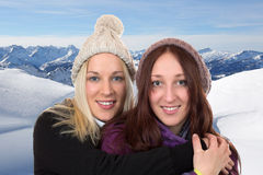 Young women in winter with snow in the mountains Stock Photos