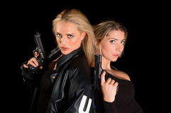 Young Women With Guns Stock Photography