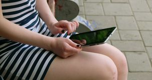 Young women work in an internet in a park stock footage