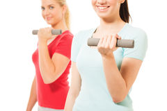 Young women working out with dumbbells Stock Photos