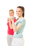 Young women working out with dumbbells Stock Photo