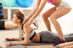 Young women working out in gym Royalty Free Stock Photos