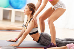Young women working out in gym Royalty Free Stock Image