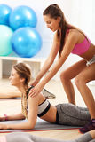 Young women working out in gym Stock Image