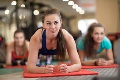 Young women working out together on rugs royalty free stock photography